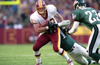 26 Nov 2000:  Stephen Alexander #80 of the Washington Redskins tries to run against Al Harris #31 of the Philadelphia Eagles during the game at the FedEx Field in Landover, Maryland. The Eagles defeated the Redskins 23-20.Mandatory Credit: Jamie Squire  /
