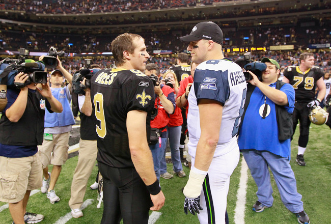 NEW ORLEANS - NOVEMBER 21:  Quarterback Matt Hasselbeck #8 of the Seattle Seahawks converses with quarterback Drew Brees #9 of the New Orleans Saints after the Saints 34-19 win at Louisiana Superdome on November 21, 2010 in New Orleans, Louisiana.  (Photo