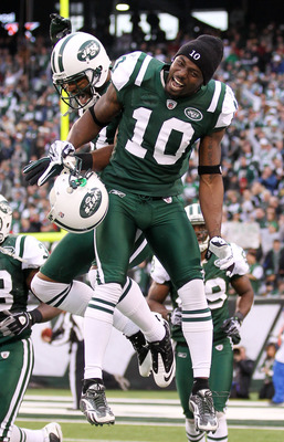 EAST RUTHERFORD, NJ - JANUARY 02:  Braylon Edwards #17 and Santonio Holmes #10 of the New York Jets celebrate Edwards' third quarter touchdown against the Buffalo Bills at New Meadowlands Stadium on January 2, 2011 in East Rutherford, New Jersey.  (Photo