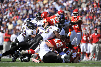BALTIMORE - SEPTEMBER 13:  The Baltimore Ravens defense led by Ray Lewis #52 swarms Mike Goff #79 of the Kansas City Chiefs at M&T Bank Stadium on September 13, 2009 in Baltimore, Maryland. The Ravens defeated the Chiefs 38-24. (Photo by Larry French/Gett