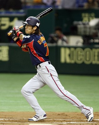 TOKYO, JAPAN - MARCH 4: Infielder Tsuyoshi Nishioka #7 of Japan watches the ball during the first round of the 2006 World Baseball Classic at the Tokyo Dome on March 4, 2006 in Tokyo, Japan. (Photo by Koichi Kamoshida/Getty Images)