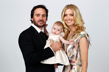 LAS VEGAS, NV - DECEMBER 03:  (L-R) Five-time champion Jimmie Johnson poses with their daughter Genevieve Marie and his wife Chandra during the NASCAR Sprint Cup Series awards banquet at the Wynn Las Vegas Hotel on December 3, 2010 in Las Vegas, Nevada.