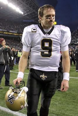 SEATTLE, WA - JANUARY 08:  Quarterback Drew Brees #9 of the New Orleans Saints walks off the field after the Saints were defeated 41-36 by the Seattle Seahawks during the 2011 NFC wild-card playoff game at Qwest Field on January 8, 2011 in Seattle, Washin