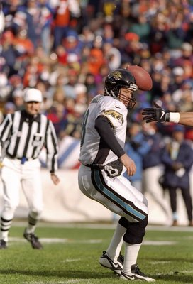 27 Dec 1997:  Quarterback Mark Brunell of the Jacksonville Jaguars tries to avoid the pressure during a game against the Denver Broncos at Mile High Stadium in Denver, Colorado.  Denver won the game 42-17. Mandatory Credit: Brian Bahr  /Allsport