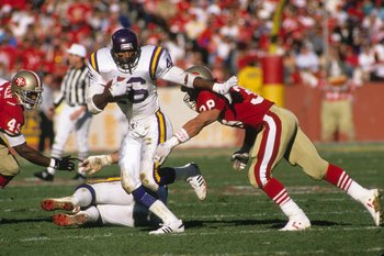 SAN FRANCISCO - JANUARY 1:  Running back Alfred Anderson #46 of the Minnesota Vikings looks for room to run against Jeff Fuller #49 and Greg Cox #38 of the San Francisco 49ers during the 1988 NFC Divisional Playoffs at Candlestick Park on January 1, 1989