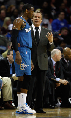 CHARLOTTE, NC - JANUARY 08:  Head coach Flip Saunders and John Wall #2 of the Washington Wizards talk on the sidelines during their game agains the Charlotte Bobcats at Time Warner Cable Arena on January 8, 2011 in Charlotte, North Carolina. NOTE TO USER: