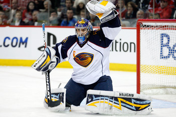 MONTREAL, CANADA - JANUARY 2:  Ondrej Pavelec #31 of the Atlanta Thrashers makes a glove save on the puck during the NHL game against the Montreal Canadiens at the Bell Centre on January 2, 2011 in Montreal, Quebec, Canada.  (Photo by Richard Wolowicz/Get