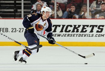 NEWARK, NJ - DECEMBER 31:  Tobias Enstrom #39 of the Atlanta Thrashers skates against the New Jersey Devils at the Prudential Center on December 31, 2010 in Newark, New Jersey. The Devils defeated the Thrashers 3-1.  (Photo by Jim McIsaac/Getty Images)