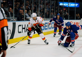 NEW YORK - NOVEMBER 22:  Jerome Iginla #12 of the Calgary Flames with the puck the puck defended by Marc Staal #18 the New York Rangers on November 22, 2010 at Madison Square Garden in New York City.  (Photo by Lou Capozzola/Getty Images)
