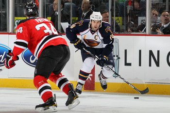 NEWARK, NJ - DECEMBER 31:  Andrew Ladd #16 of the Atlanta Thrashers skates against the New Jersey Devils at the Prudential Center on December 31, 2010 in Newark, New Jersey. The Devils defeated the Thrashers 3-1.  (Photo by Jim McIsaac/Getty Images)