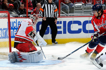 WASHINGTON - NOVEMBER 28:  Cam Ward #30 of the Carolina Hurricanes makes a save against Alex Ovechkin #8 of the Washington Capitals at the Verizon Center on November 28, 2010 in Washington, DC.  (Photo by Greg Fiume/Getty Images)