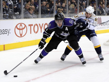 LOS ANGELES, CA - JANUARY 06:  Anze Kopitar #11 of the Los Angeles Kings keeps Shane O'Brien #55 of the Nashville Predators from the puck as he looks to make a play during the game at the Staples Center on January 6, 2011 in Los Angeles, California.  (Pho