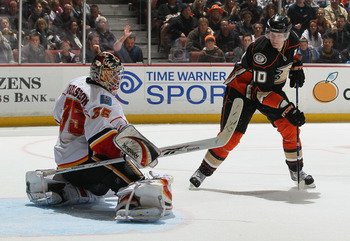 ANAHEIM, CA - DECEMBER 10:  Goaltender Henrik Karlsson #35 of the Calgary Flames defends against Corey Perry #10 of the Anaheim Ducks at the Honda Center on December 10, 2010 in Anaheim, California. (Photo by Jeff Gross/Getty Images)