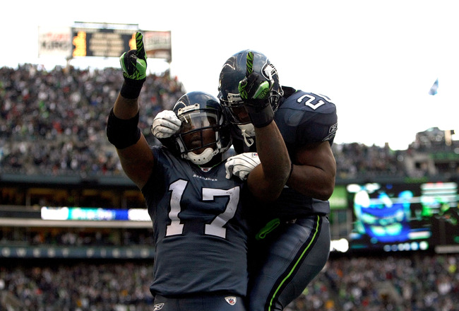 SEATTLE, WA - JANUARY 08:  Wide receiver Mike Williams #17 of the Seattle Seahawks reacts with teammate Justin Forsett #20 after catching a 38-yard third quarter touchdown pass against the New Orleans Saints during the 2011 NFC wild-card playoff game at Q
