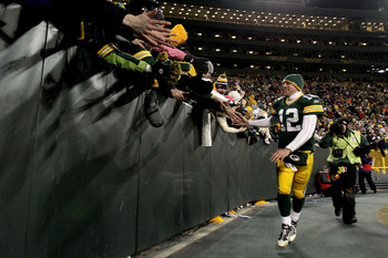 GREEN BAY, WI - JANUARY 02:  Quarterback Aaron Rodgers #12 of the Green Bay Packers circles the field after the Packers win over the Chicago Bears at Lambeau Field on January 2, 2011 in Green Bay, Wisconsin.  (Photo by Matthew Stockman/Getty Images)