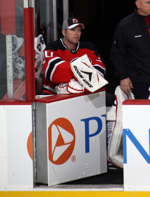 NEWARK, NJ - JANUARY 06:  Martin Brodeur #30 of the New Jersey Devils watches the game from the bench against the Philadelphia Flyers at the Prudential Center on January 6, 2011 in Newark, New Jersey.  (Photo by Bruce Bennett/Getty Images)