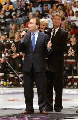 LOS ANGELES - OCTOBER 9:  Commisioner of the NHL Gary Bettman talks during a pre-game ceremony as the Kings retire Wayne Gretzky's jersey prior to the start of the NHL game against the Phoenix Coyotes on October 9, 2002 at the Staples Center in Los Angele