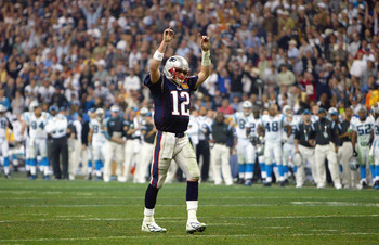 HOUSTON - FEBRUARY 1:  Quarterback Tom Brady #12 of the New England Patriots raises his arms in celebration of a play against the Carolina Panthers during Super Bowl XXXVIII at Reliant Stadium on February 1, 2004 in Houston, Texas.  The Patriots defeated