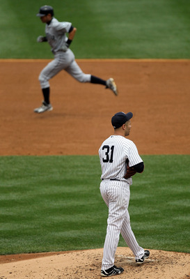 NEW YORK - AUGUST 21:  Javier Vazquez #31 of the New York Yankees looks on after surrendering a third inning home run to Ichiro Suzuki #51 of the Seattle Mariners on August 21, 2010 at Yankee Stadium in the Bronx borough of New York City.  (Photo by Jim M