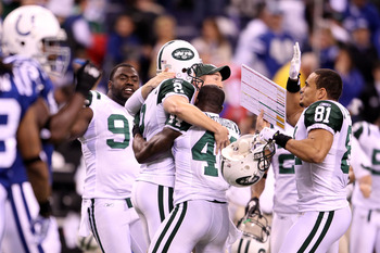 INDIANAPOLIS, IN - JANUARY 08:  Place kicker Nick Folk #2 of the New York Jets celebrates with Shaun Ellis #92, James Ihedigbo #44 and Dustin Keller #81 after Folk successfully kicked a game-winning a 32-yard field goal in the fourth quarter to win 17-16