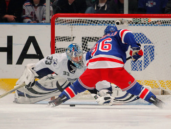 NEW YORK, NY - DECEMBER 23:  Mats Zuccarello #36 of the New York Rangers scores a goal past Dan Ellis #33 of the Tampa Bay Lightning during a shootout in an NHL hockey game at Madison Square Garden on December 23, 2010 in New York City.  (Photo by Paul Be