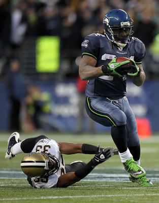 SEATTLE, WA - JANUARY 08:  Running back Marshawn Lynch #24 of the Seattle Seahawks runs for a 67-yard touchdown run in the fourth quarter against Jabari Greer #33 of the New Orleans Saints during the 2011 NFC wild-card playoff game at Qwest Field on Janua