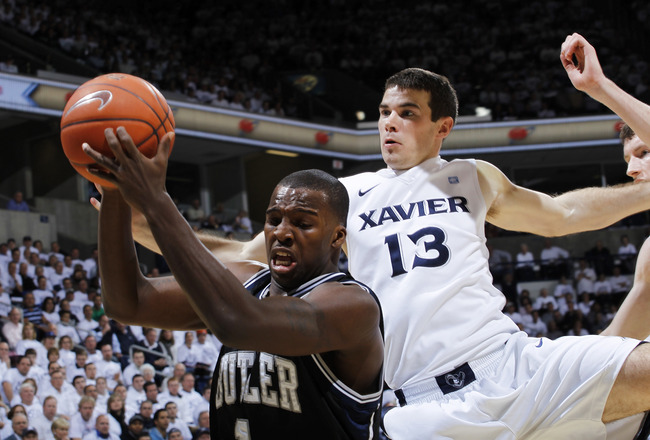 CINCINNATI, OH - DECEMBER 9: Shelvin Mack #1 of the Butler Bulldogs pulls a rebound away from Kevin Feeney #13 of the Xavier Musketeers at Cintas Center on December 9, 2010 in Cincinnati, Ohio. (Photo by Joe Robbins/Getty Images)