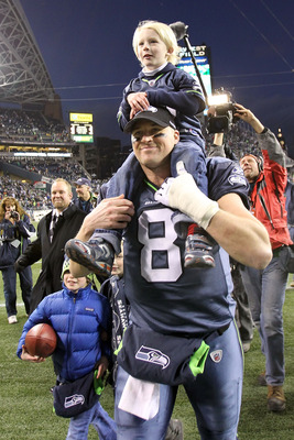 SEATTLE, WA - JANUARY 08:  Quarterback Matt Hasselbeck #8 of the Seattle Seahawks celebrates the Seahawks 41-36 victory against the New Orleans Saints as his son Henry Hasselbeck is carried off on his back after the 2011 NFC wild-card playoff game at Qwes