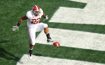 ORLANDO, FL - JANUARY 01: Mark Ingram #22 of the Alabama Crimson Tide scores a touchdown during the Capitol One Bowl against the Michigan State Spartans at the Florida Citrus Bowl on January 1, 2011 in Orlando, Florida.  (Photo by Mike Ehrmann/Getty Image