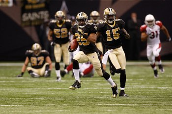 NEW ORLEANS - JANUARY 16:  Reggie Bush #25 of the New Orleans Saints scores on a 83-yard punt return for a touchdown in the third quarter against the Arizona Cardinals during the NFC Divisional Playoff Game at Louisana Superdome on January 16, 2010 in New