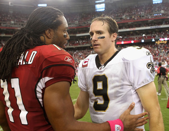GLENDALE, AZ - OCTOBER 10:  Quarterback Drew Brees #9 of the New Orleans Saints talks with Larry Fitzgerald #11 of the Arizona Cardinals following the NFL game at the University of Phoenix Stadium on October 10, 2010 in Glendale, Arizona. The Cardinals de