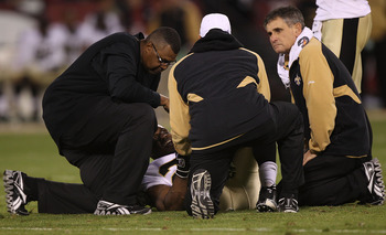 SAN FRANCISCO - SEPTEMBER 20:  Reggie Bush #25 of the New Orleans Saints lies on the ground injured against the San Francisco 49ers during an NFL game at Candlestick Park on September 20, 2010 in San Francisco, California.  (Photo by Jed Jacobsohn/Getty I
