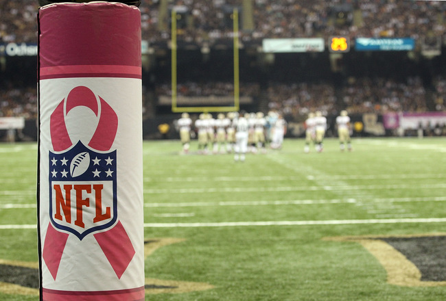 NEW ORLEANS - OCTOBER 03:  A pink ribbon with the NFL logo in support of Breast Cancer Awareness on the goal post during a game between the Carolina Panthers and the New Orleans Saints at the Louisiana Superdome on October 3, 2010 in New Orleans, Louisian