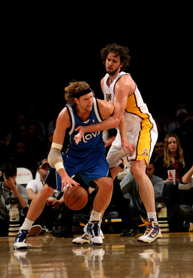 LOS ANGELES, CA - JANUARY 03: Dirk Nowitzki #41 of the Dallas Mavericks driveas against Pau Gasol #16 of the Los Angeles Lakers on January 3, 2010 at Staples Center in Los Angeles, California. NOTE TO USER: User expressly acknowledges and agrees that, by
