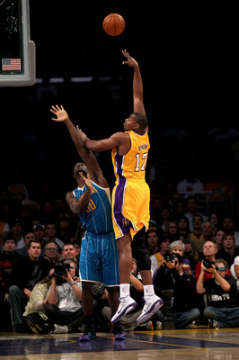 LOS ANGELES, CA - JANUARY 7:  Andrew Bynum #17 of the Los Angeles Lakers shoots over Emeka Okafor #50 of the New Orleans Hornets at Staples Center on January 7, 2011 in Los Angeles, California.  NOTE TO USER: User expressly acknowledges and agrees that, b