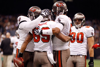 NEW ORLEANS, LA - JANUARY 02:  Quarterback Josh Freeman #5 celebrates after throwing a touchdown  with Dezmon Briscoe #89 of the Tampa Bay Buccaneers during the game against the New Orleans Saints at the Louisiana Superdome on January 2, 2011 in New Orlea