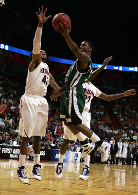 MIAMI - MARCH 22:  Forward Jordan Hill #43 of the  University of Arizona Wildcats blocks the shot of guard Norris Cole #30 of the Cleveland State University Vikings during the second round of the NCAA Division I Men's Basketball Tournament at the American