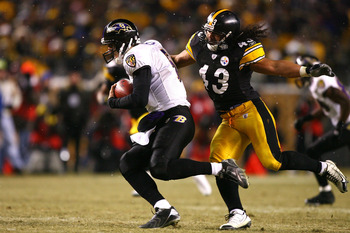 PITTSBURGH - JANUARY 18:  Troy Polamalu #43 of the Pittsburgh Steelers runs down Joe Flacco #5 of the Baltimore Ravens during the AFC Championship game on January 18, 2009 at Heinz Field in Pittsburgh, Pennsylvania.  (Photo by Al Bello/Getty Images)