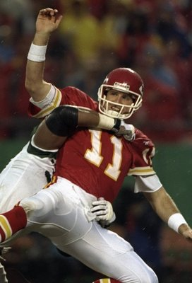 1 Nov 1998:  Quarterback Elvis Grbac #11 of the Kansas City Chiefs getting tackled by Anthony Pleasant during the game against the New York Jets at the Arrowhead Stadium in Kansas City, Missouri. The Jets defeated the Chiefs 20-17. Mandatory Credit: Jon F