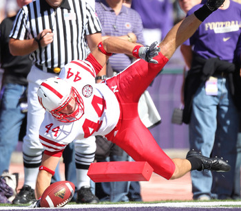 SEATTLE - SEPTEMBER 18:  Tight end Mike McNeill #44 of the Nebraska Cornhuskers scores a touchdown in the first quarter against the Washington Huskies on September 18, 2010 at Husky Stadium in Seattle, Washington. The Cornhuskers defeated the Huskies 56-2