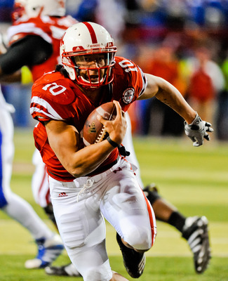 LINCOLN, NE - NOVEMBER 13: Roy Helu Jr. #10 of the Nebraska Cornhuskers runs for the endzone the Kansas Jayhawks during their game at Memorial Stadium on November 13, 2010 in Lincoln, Nebraska. Nebraska Defeated Kansas 20-3. (Photo by Eric Francis/Getty I