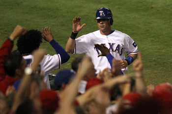ARLINGTON, TX - OCTOBER 22:  Michael Young #10 of the Texas Rangers celebrates at the dugout after scoring in the seventh inning of Game Six of the ALCS against the New York Yankees during the 2010 MLB Playoffs at Rangers Ballpark in Arlington on October