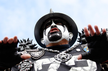 JACKSONVILLE, FL - DECEMBER 12:  A fan of the Oakland Raiders cheers during the game against the Jacksonville Jaguars at EverBank Field on December 12, 2010 in Jacksonville, Florida.  (Photo by Sam Greenwood/Getty Images)