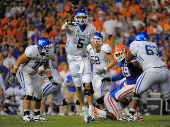 GAINESVILLE, FL - SEPTEMBER 25:  Quarterback Mike Hartline #5 of the Kentucky Wildcats throws a pass against the Florida Gators at Ben Hill Griffin Stadium on September 25, 2010 in Gainesville, Florida. Florida defeated Kentucky 48-14 for head coach Urban