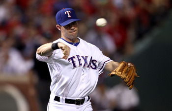 ARLINGTON, TX - OCTOBER 22:  Michael Young #10 of the Texas Rangers throws the ball against the New York Yankees in Game Six of the ALCS during the 2010 MLB Playoffs at Rangers Ballpark in Arlington on October 22, 2010 in Arlington, Texas.  (Photo by Elsa