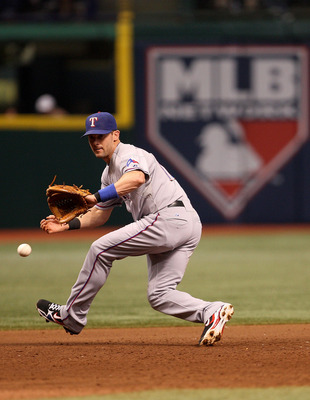 ST PETERSBURG, FL - OCTOBER 07:  Michael Young #10 of the Texas Rangers fields a ground ball during Game 2 of the ALDS against the Tampa Bay Rays at Tropicana Field on October 7, 2010 in St. Petersburg, Florida.  (Photo by Mike Ehrmann/Getty Images)
