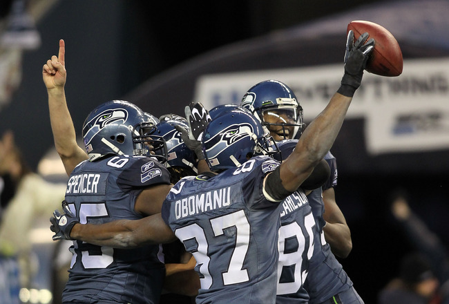 SEATTLE, WA - JANUARY 08:  Running back Marshawn Lynch #24 of the Seattle Seahawks celebrates with his teammates his 67-yard touchdown run in the fourth quarter against the New Orleans Saints during the 2011 NFC wild-card playoff game at Qwest Field on Ja