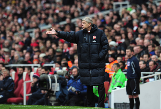 LONDON, ENGLAND - JANUARY 08:  Arsene Wenger the Arsenal coach points his instructions during the FA Cup sponsored by E.ON 3rd Round match between Arsenal and Leeds United at Emirates Stadium on January 8, 2011 in London, England.  (Photo by Shaun Botteri
