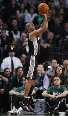BOSTON, MA - JANUARY 05:  Tony Parker #9 of the San Antonio Spurs takes a shot in the first half against the Boston Celtics on January 5, 2011 at the TD Garden in Boston, Massachusetts. NOTE TO USER: User expressly acknowledges and agrees that, by downloa