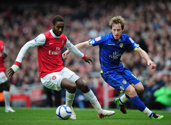 LONDON, ENGLAND - JANUARY 08:  Johan Djourou  of Arsenal is challenged by Luciano Becchio of Leeds United during the FA Cup sponsored by E.ON 3rd Round match between Arsenal and Leeds United at Emirates Stadium on January 8, 2011 in London, England.  (Pho